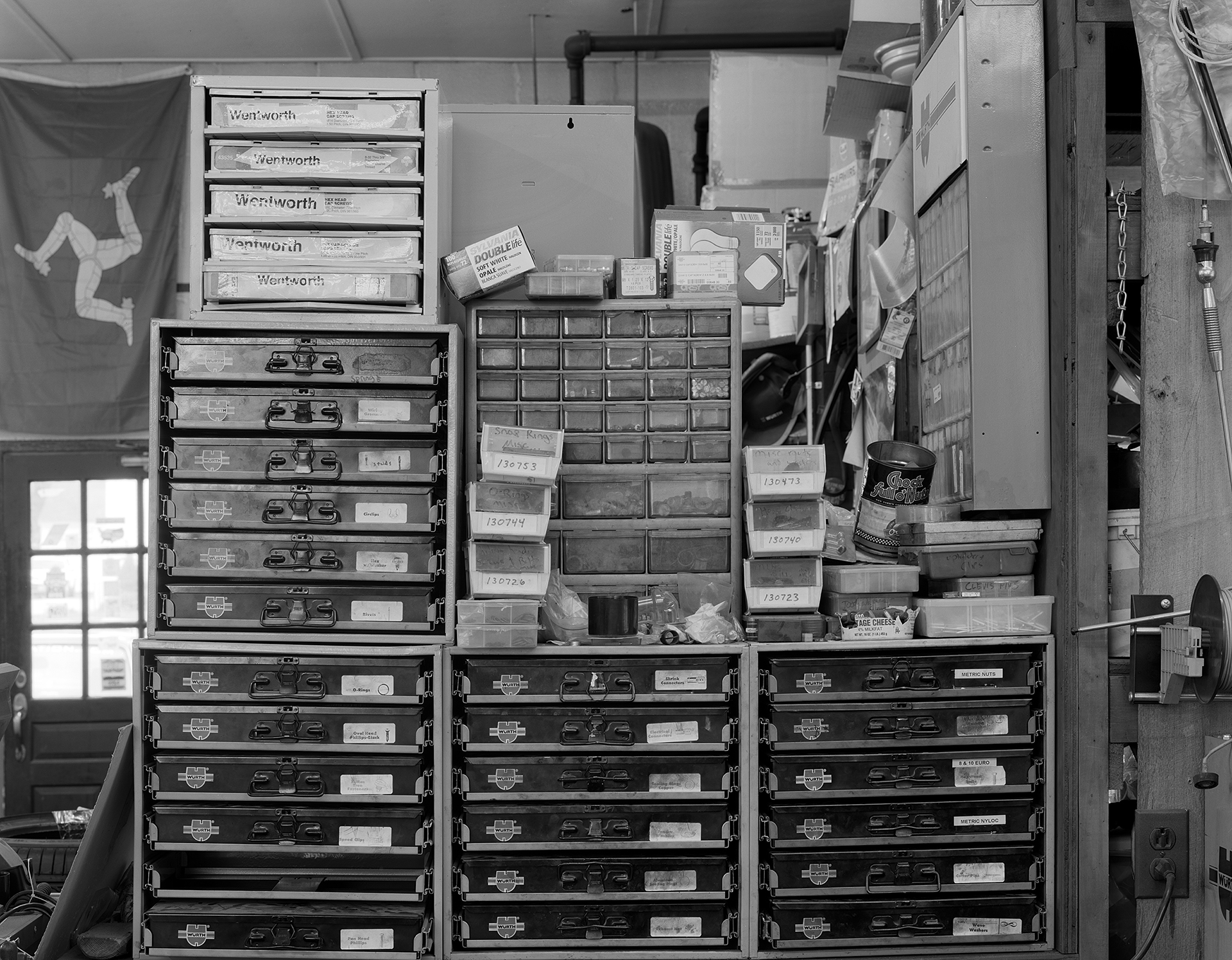 Black & white shot of AVA Restoration services parts boxes