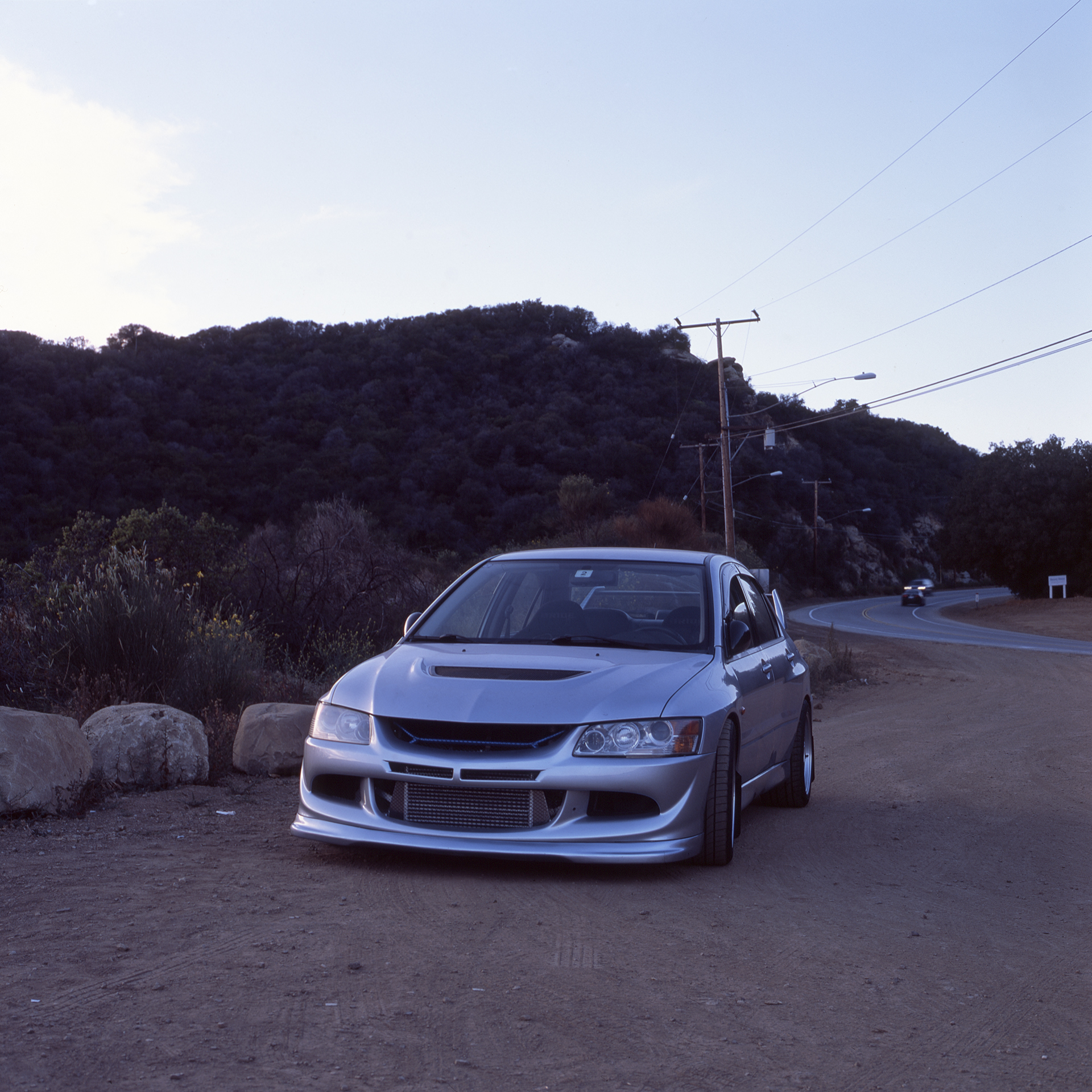 Evo parked at one of the dirt overlooks somewhere in the Malibu hills